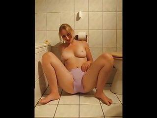 Naked beauties peeing - Beautiful blonde peeing in the bathroom