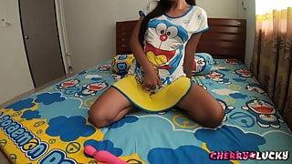 Asian girl sucking toy