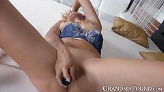Grandma with thick thighs enjoys using big dildos for fun
