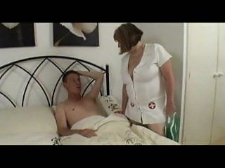 Vaginal swelling from sex - Mature nurse in stockings treats the swelling