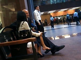Asian business publications Candid asian business lady feet shoeplay dangling in pumps