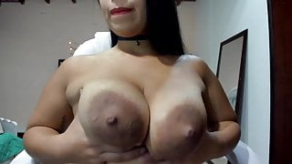 Big heavy breasts with dark rosebud nipples