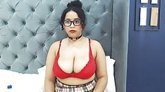 Curly Latina with glasses reveals huge boobs on cam