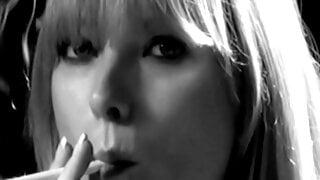 Blonde smokes seductlively