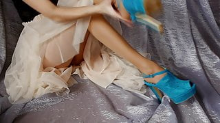 ASMR – girl in beautiful shoes & a skirt is scratching her leg