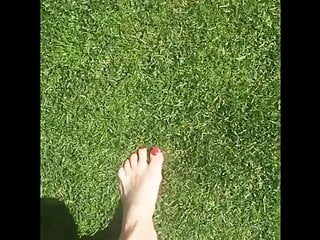 Big breasts mowing the lawn Barefoot on the lawn