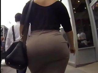 Transgender walking - Candid big ass walking in tight work dress