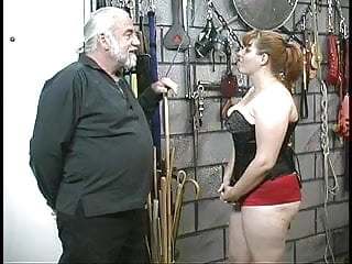 Fetish corset links - Young bdsm slave girl brunette in corset is spanked and caned in basement