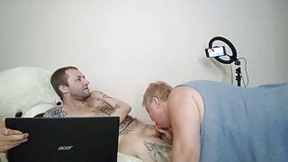 jerking off and sucking my cock while I play on the computer