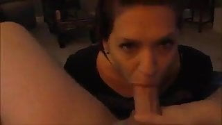 She sits in front of his cock and sucks till cum in mouth