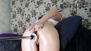 Asian girl sticks her fingers in anal