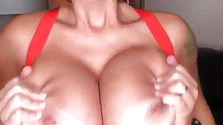 Big fake tits groped from behind