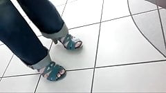 Friend's feet in blue sandals