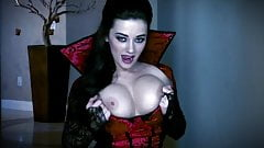 Busty vampire strips & touches herself