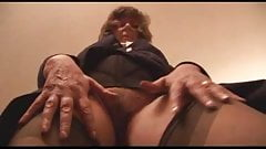 granny in stockings shows her pussy