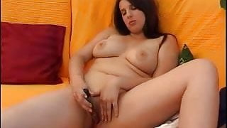 Chubby girl with long hair pokes her pussy