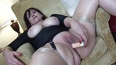 Busty mature Tanya in sheer panties and stockings with toy