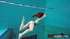 Pierced teen swimming