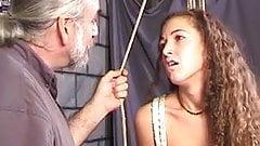 Slim bondaged brunette smiles as older dude binds her arms and hands