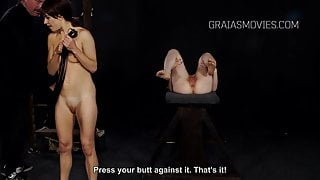 Two slave whipping each others pussies