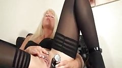 Iam Pierced  MILF in stockings with black anal toy