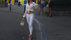 hooker walking in the street in sexy high heels and legging