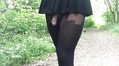 Cock walk in the woods in black suspender tights.