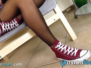 Lick sneaker Teen brunette takes off her sneakers and shows sexy feet in