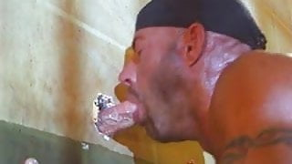 Horny inmate sucks off cock through gloryhole