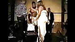 Old school video woman sucks male strippers cock on stage