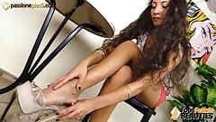 Beautiful teen brunette takes off her elegant high heels