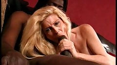 White blonde with big tits loves to get a big black cock in her mouth