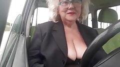 Naughty granny with big natural boobs masturbates in the car