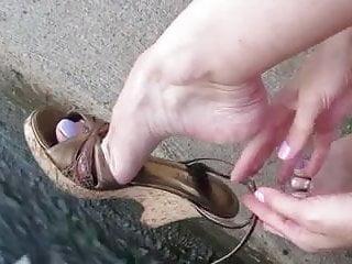 Mature feminine bicep flexing Flexes feet in sandals