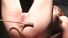 Tied female slave is spanked on her ass and pussy