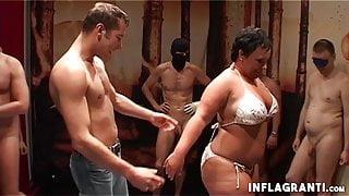 European brunette BBW gets fucked in group sex scene