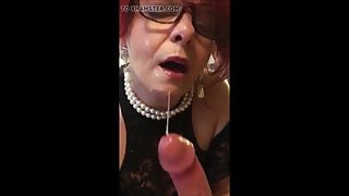 Redhead gilf with glasses gives a sloppy blowjob