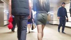 Blonde girl's ass in short skirt