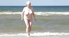 Wife undressing on beach