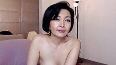 Older Asian milf teases, big tits