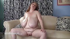 Massive hanging tits soaked in oil