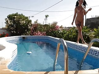 Naked night swim - Sexy brunette naked and squirting on her swimming pool