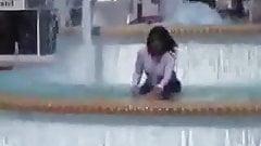 Marjorie is getting wet in a public fountain - outdoor
