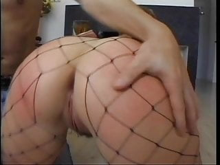 Brunette mature fishnets - Horny mature slut in fishnets gets her ass licked