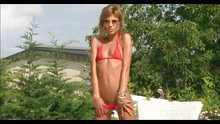 Bikini Pleasure-Blond Girl in red micro Bikini Pool
