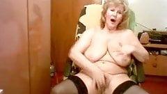 Nice looking old granny masturbates on a chair