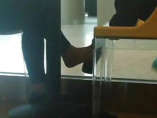 Asian coffee tables Candid shoeplay dangling feet in coffee shop