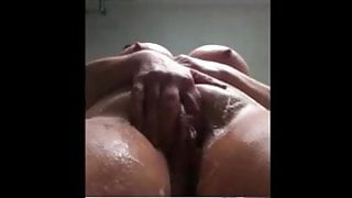 Sexy granny in shower washing juicy fat pussy