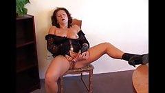 Mature lady fucks her dildo