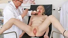 Medical examination of naked senior woman